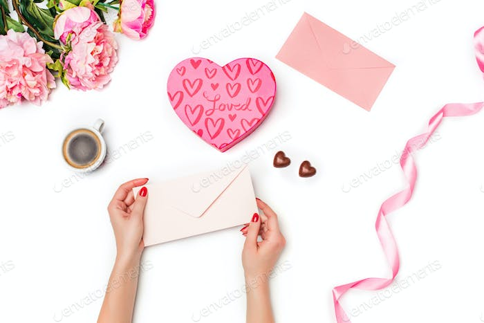 The female hands with envelope on white background