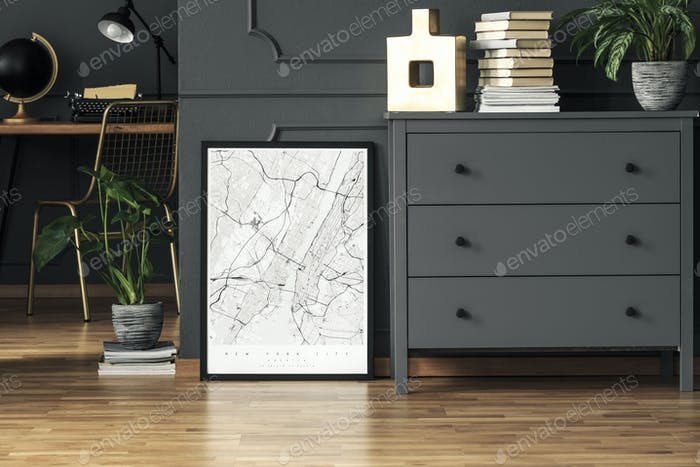 Map poster placed on the floor in real photo of dark grey room i