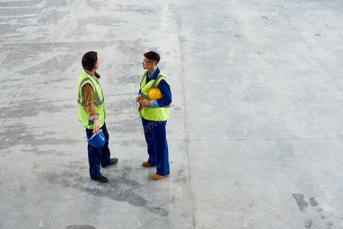 Two Female Workers Wearing Reflective Jackets