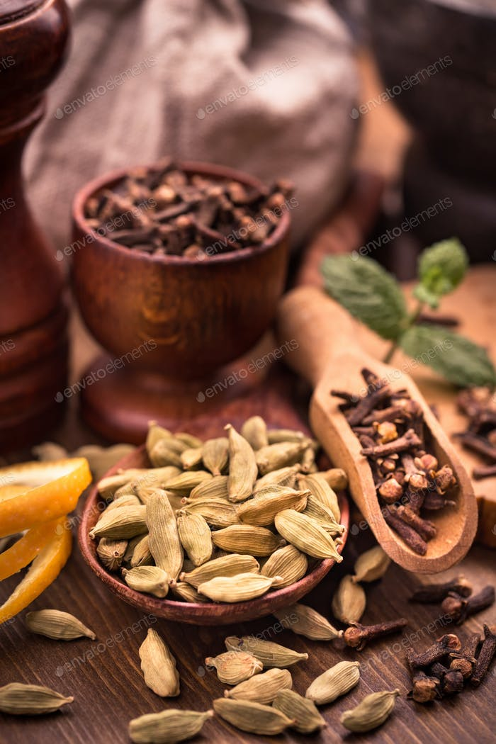 Clove and cardamom seasoning still-life