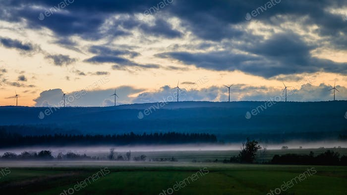 Picturesque view of fields in fog