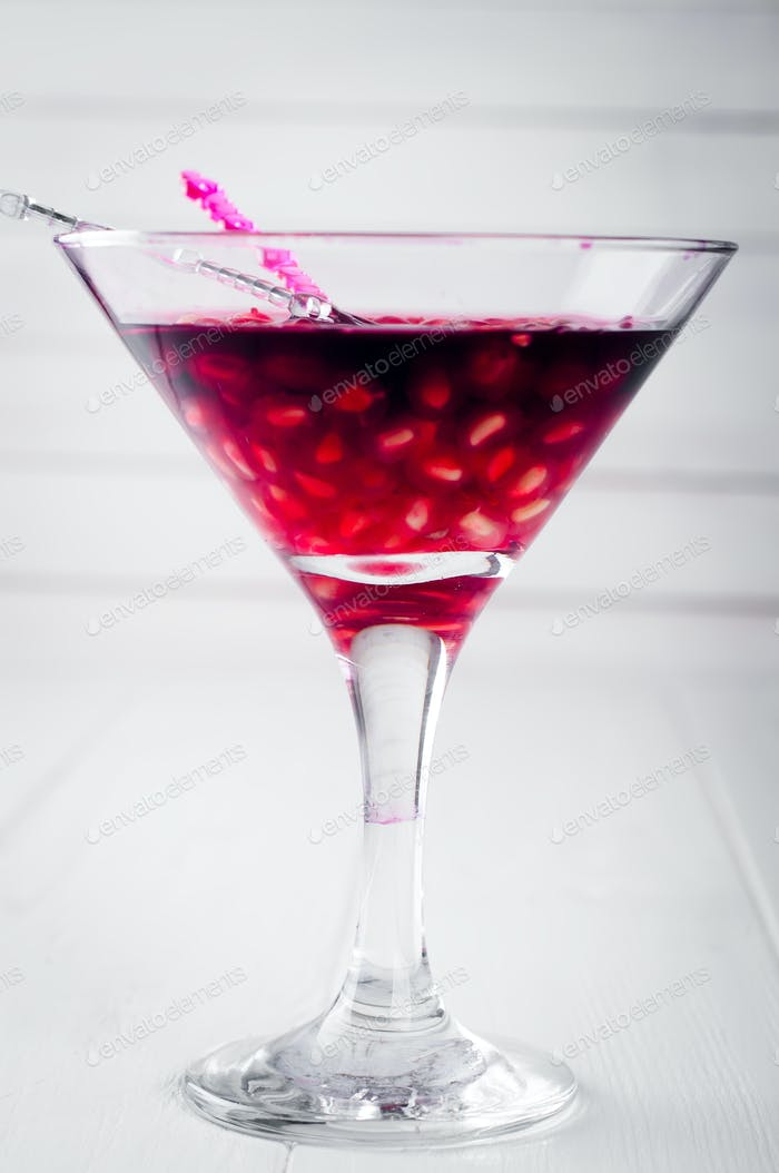pomegranate cocktail and ripe red fruit