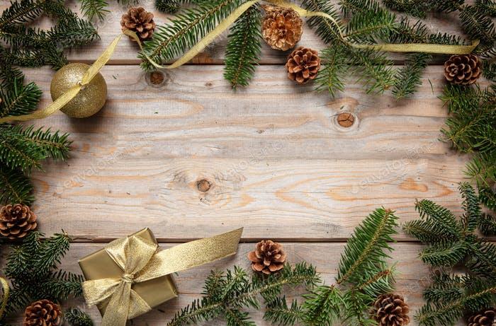 Christmas fir frame garland against wooden background