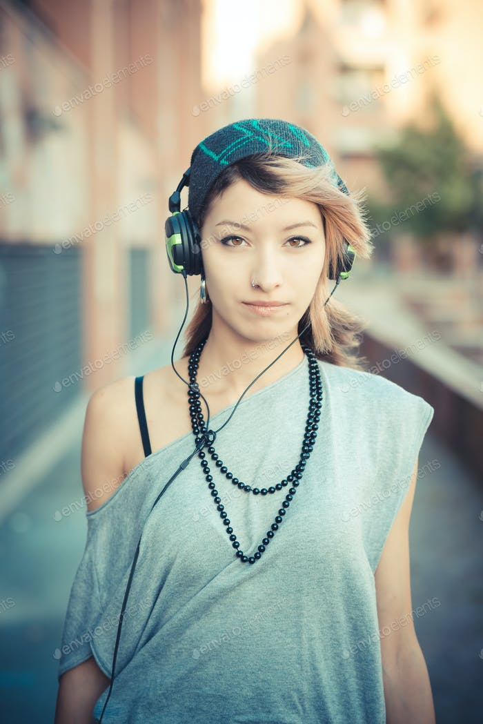 young beautiful model woman listening music