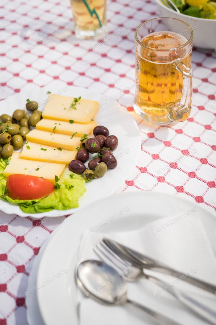 Summer salad with olives, tomatoes and cheese