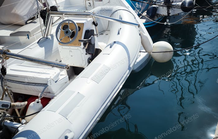 Picture of white rubber boat in harbor