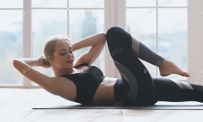 Close up of woman working out at fitness studio