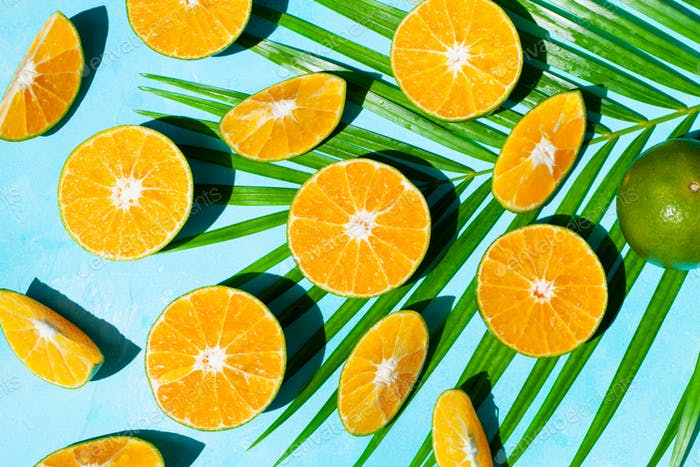 Fresh Oranges on Blue Background. Top View.