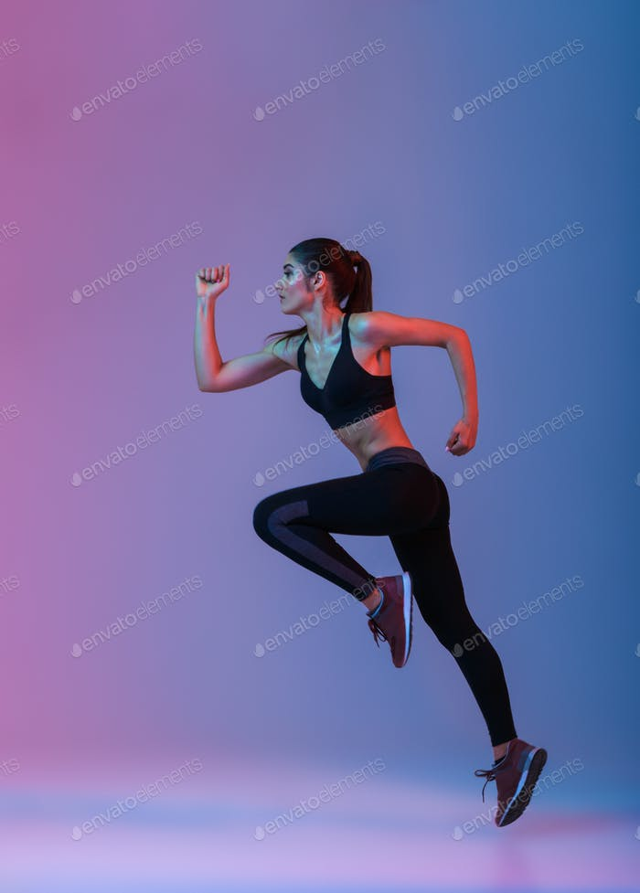 Strong young sports woman running