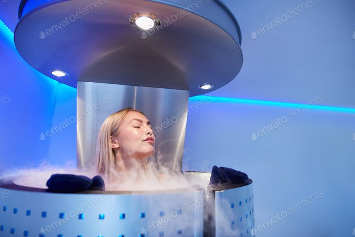 Young woman in a whole body cryo sauna