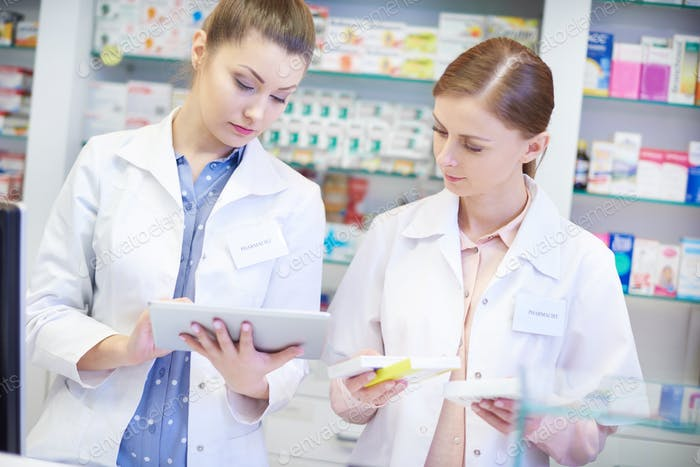 Top view of pharmacists during work
