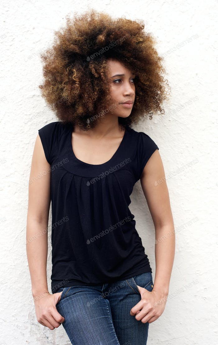 Serious young african woman looking away