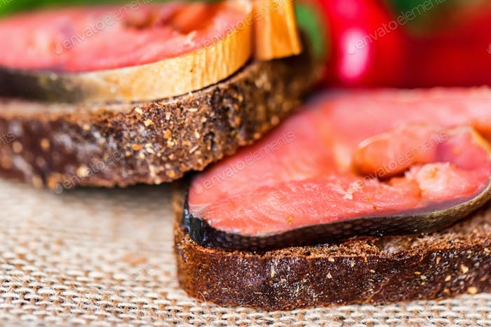 Tasty smoked salmon sandwiches with rye bread