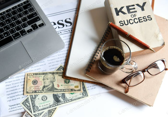 Business concepts,Key of success with coffee  , laptop and dolla