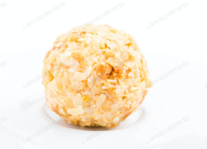 White chocolate candy with crumbled biscuit.