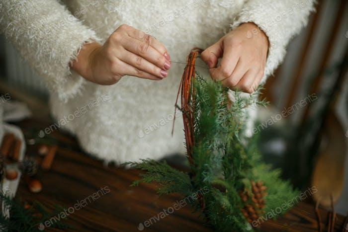 Making rustic christmas wreath, holiday advent.