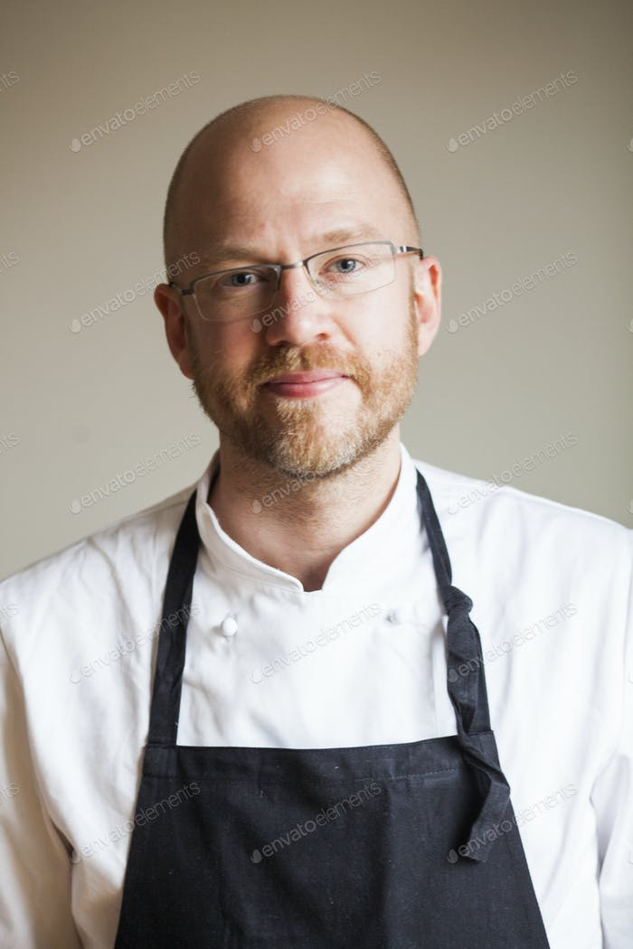 Portrait of confident male chef at restaurant