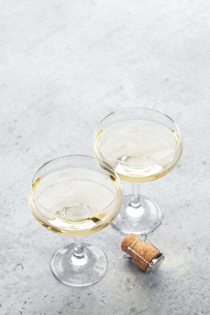 Champagne glasses on stone table
