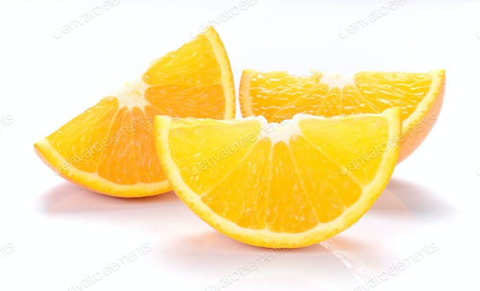 Orange cut pieces on white background.