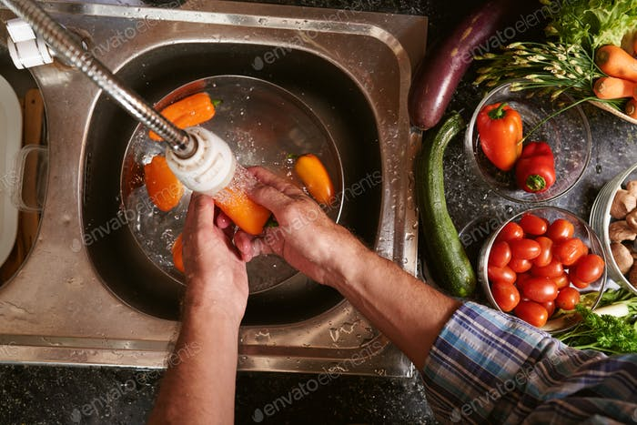 Washing bell peppers