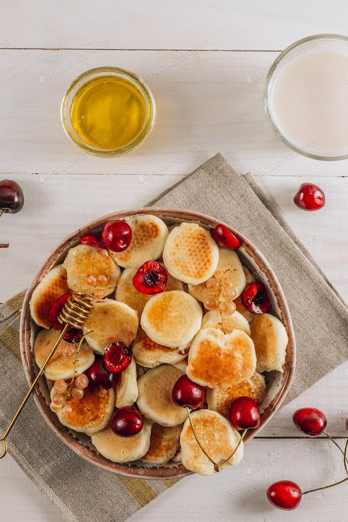 Trendy home breakfast with tiny pancakes