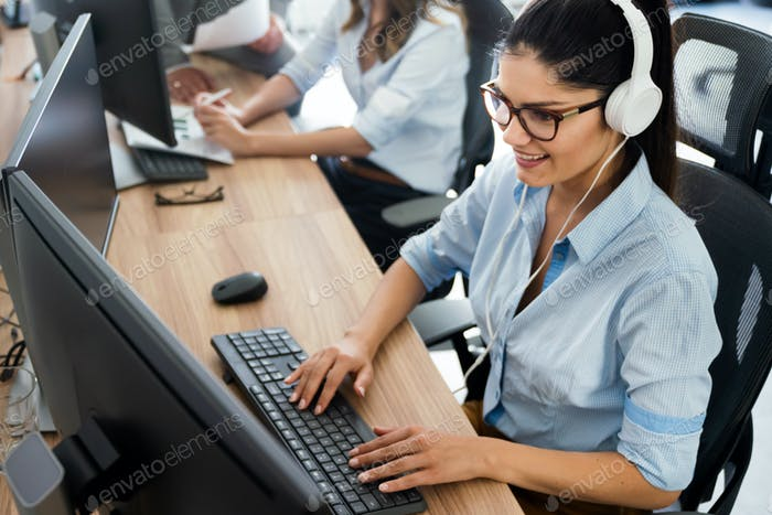 Successful happy woman working at office. Technology, computer, startup, business concept