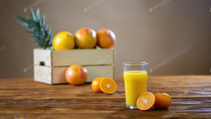 Refreshment from squeezed oranges in a tall glass