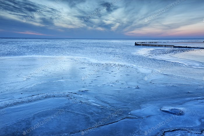 big lake frozen in dusk