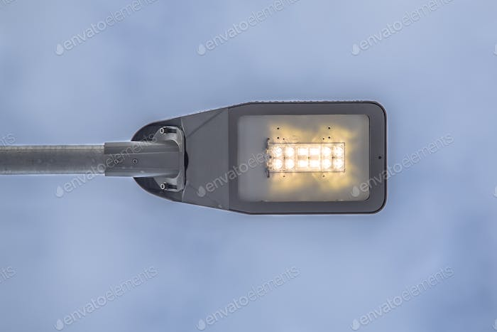 Modern LED street light against sky