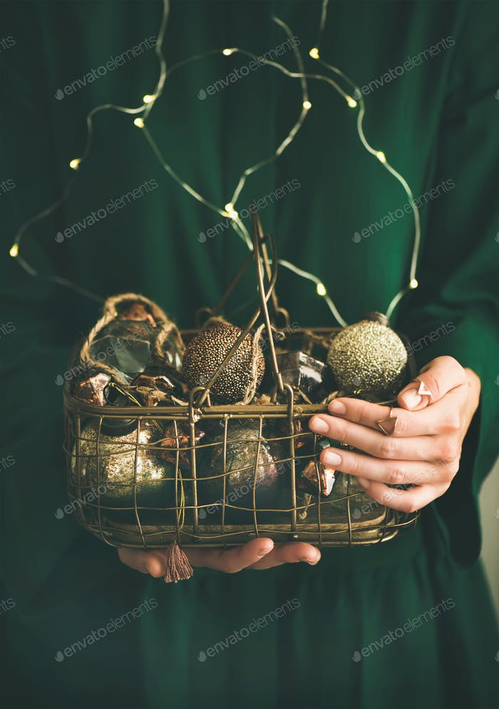 Wire basket full of Christmas or New Year decoration toys