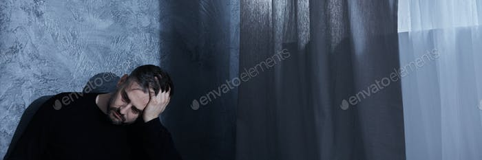 Depressed man sitting alone