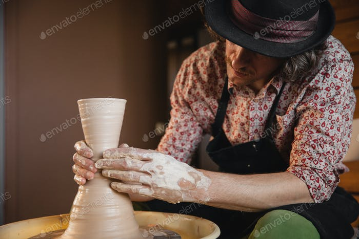Potter master creating new ceramic jug