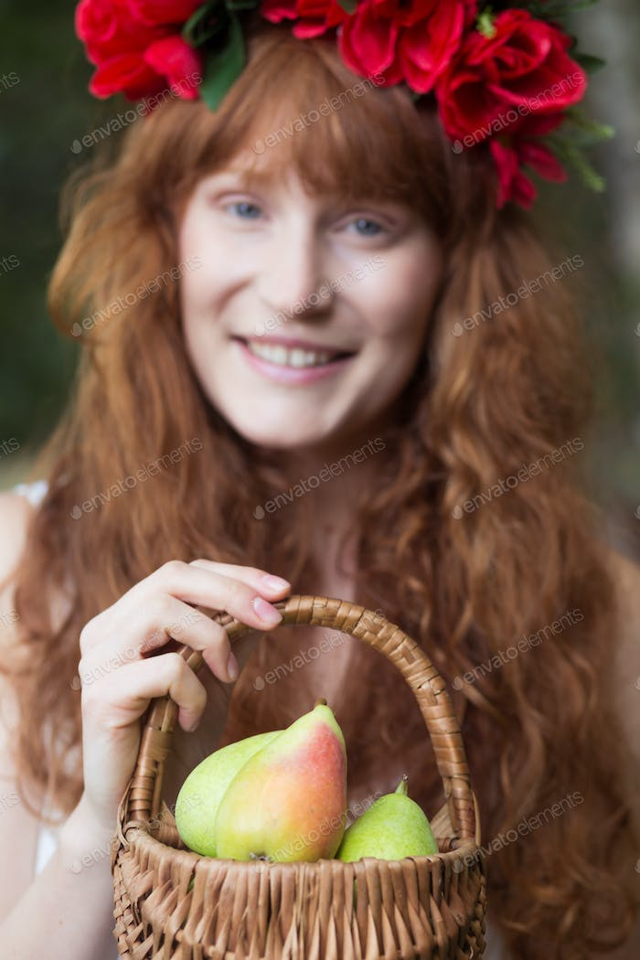 Woman holding a basket with pears