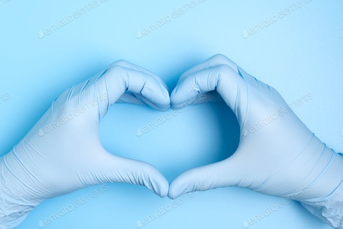 Doctor hands with gloves making heart shape