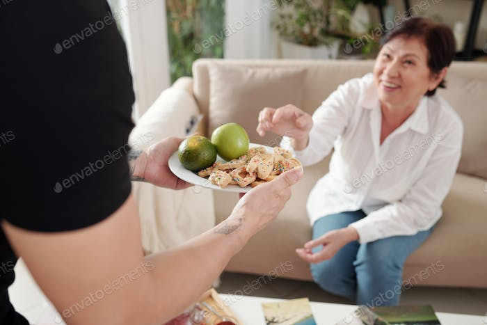 Woman treating with cookies