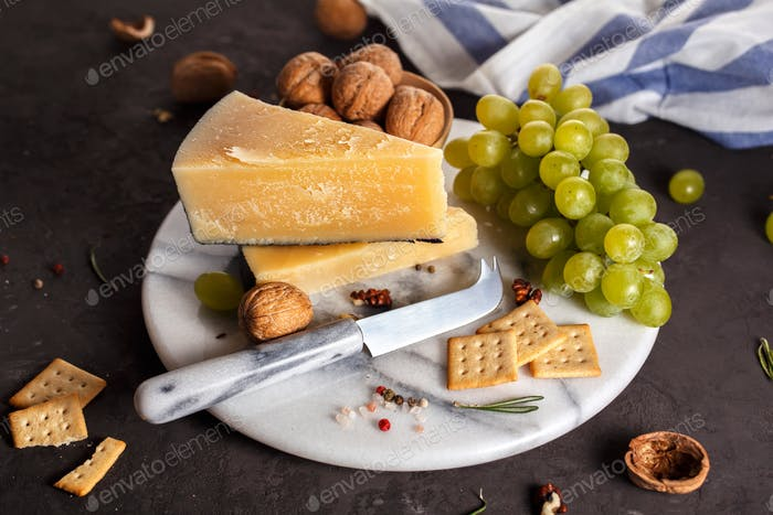 Cheese and snacks on a marble plate