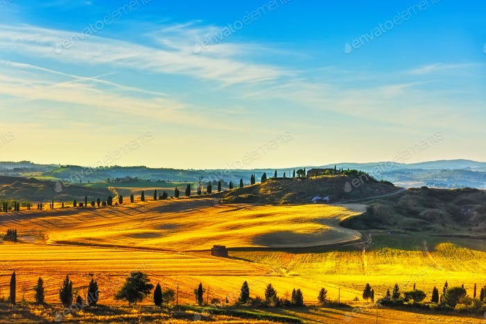 Tuscany, rural landscape. Countryside farm, green fields and cyp