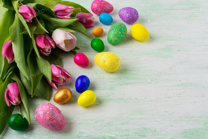 Easter background with vibrant painted eggs
