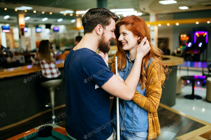Couple hugging in snooker bar