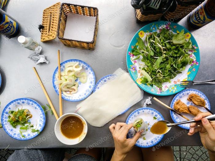 Eating fresh Vietnamese spring rolls