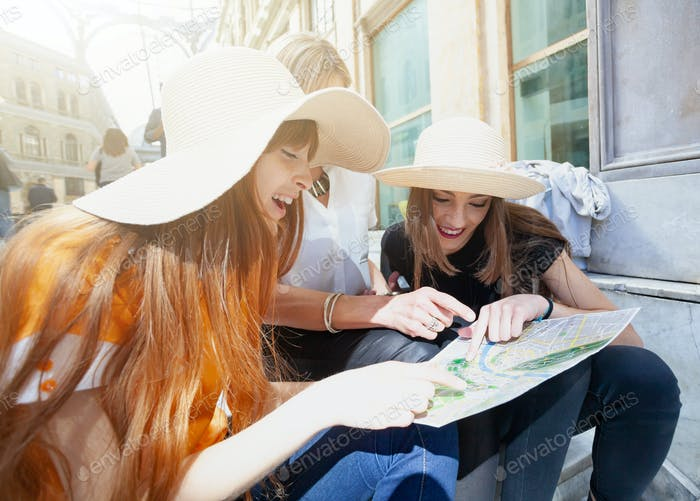 Tourists consult the map of the city