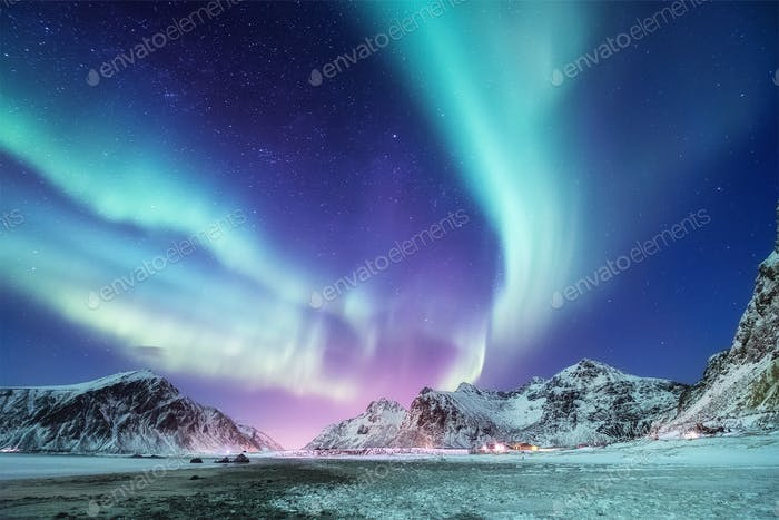 Northern Lights in the Lofoten Islands, Norway. Mountains and ocean coast