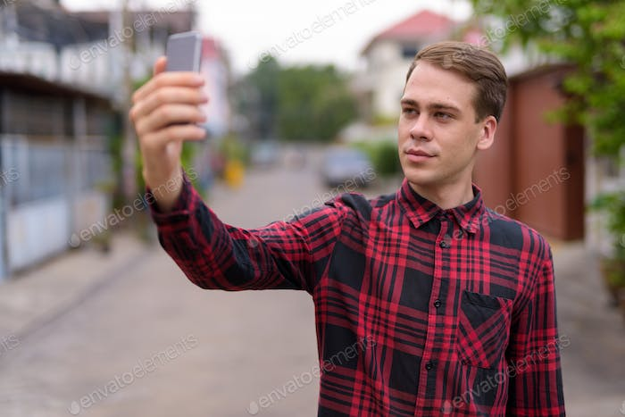 Man taking selfie outdoors