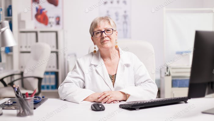 Confident senior female doctor