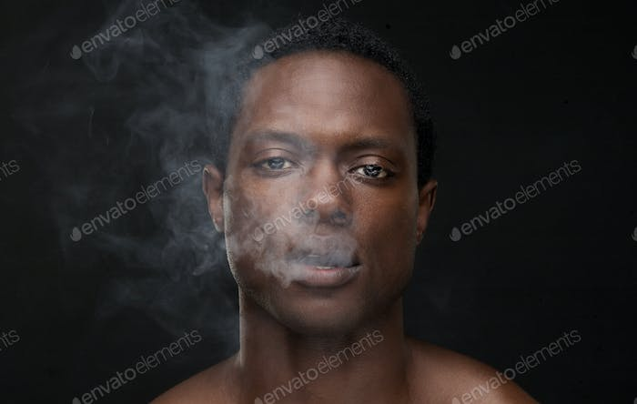 African American Man with Smoke Coming Out Mouth