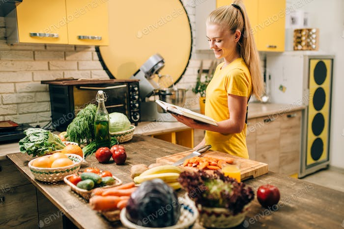 Young woman cooking on recipes, healthy eco food