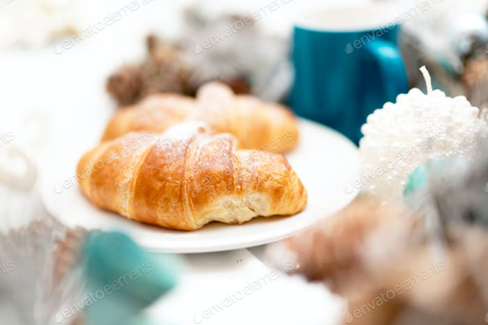Close-up of breakfast with butter croissants and espresso.