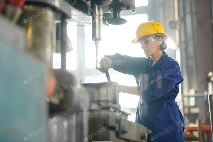 Female Mechanic Repairing Machines