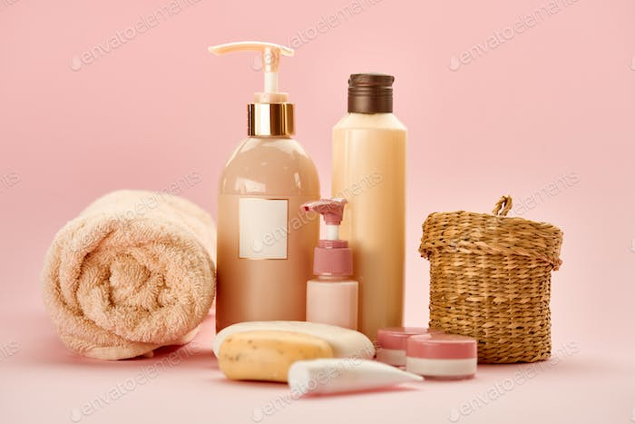 Skin care products on pink background, nobody