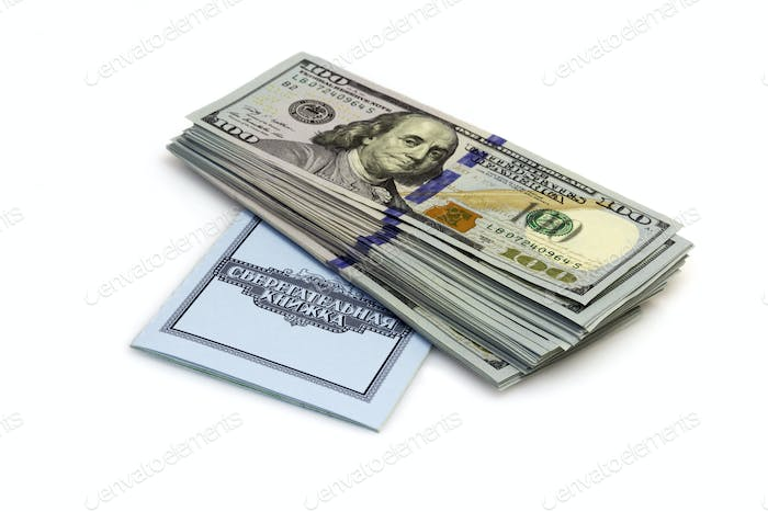 One hundred dollars banknotes lie on checkbook isolated on white background